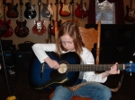 Brooke Caron studies the acoustic guitar. She is very intelligent and enjoys perfection.