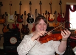Deb Ezzy has begun studying the violin. She is well on her way. That's right she has the last name as Ben cause they ar