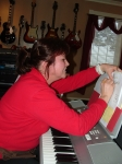 Brenda Sirois workin hard at the keyboard. Brenda loves music and hates having her picture taken,lol. She is a church or